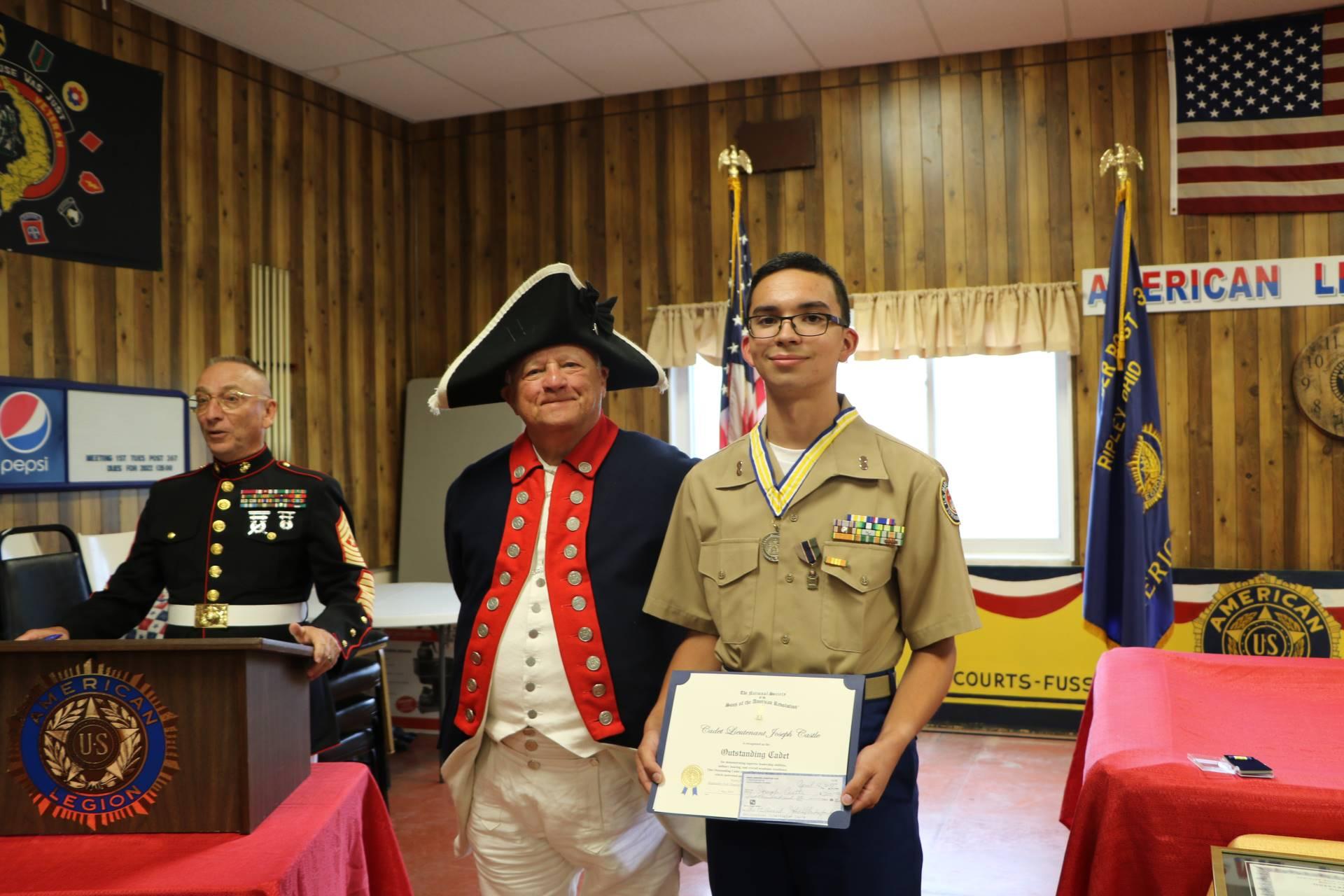 Cadet Joseph Castle receives the Sons of the American Revolution Enhanced Program Award