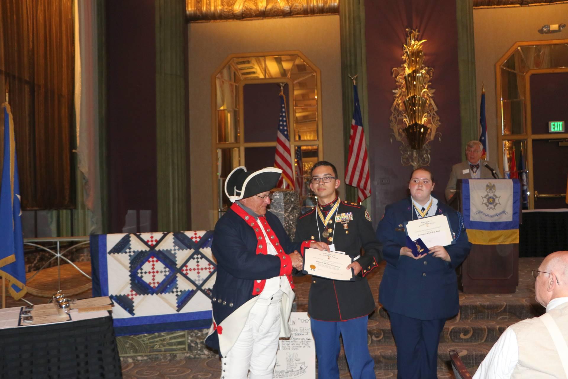 Cadet Joseph Castle receives the Sons of the American Revolution Enhanced Program Scholarship