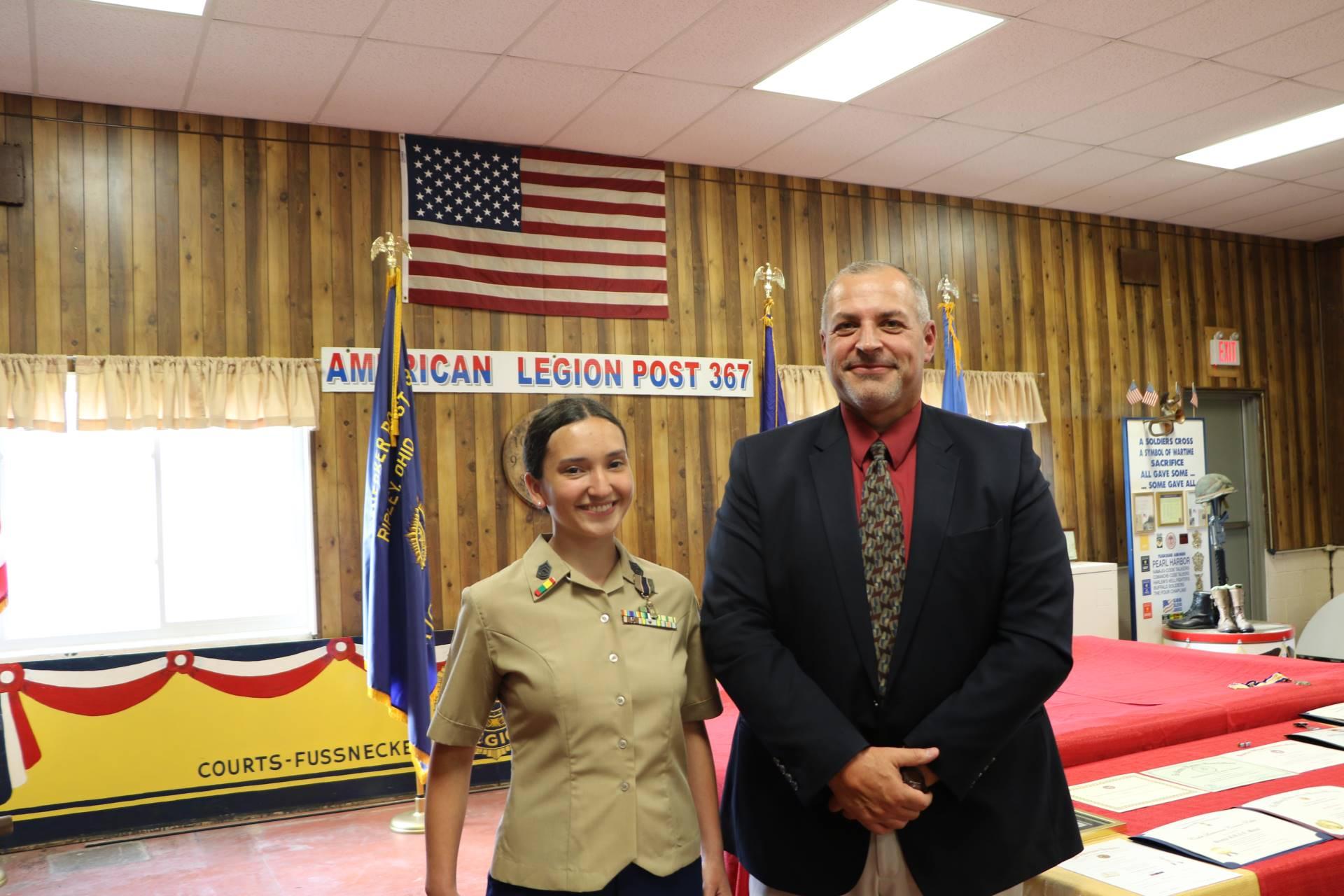 Cadet Anna Castle receives the Women Marines Association Award
